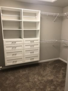 Walkin Master Closet with Specialized Shelving
